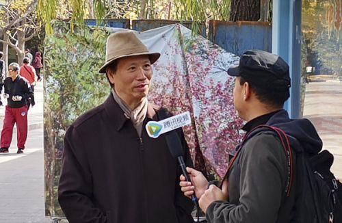 中国新闻摄影学会会长徐祖根接受媒体采访