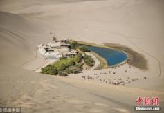 甘肃敦煌40年游客量增4500倍 遗产保护与开发并重